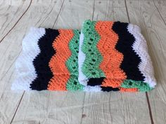 Mint green, peach and navy Crocheted baby blanket. This is a very special handmade crochet baby blanket.  This baby afghan will make a wonderful baby shower gift.  This blanket would make a lovely addition to your baby nursery decor. Perfect also, for travel, strollers, prams, cribs, tummy time and photo props