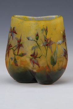 Vase, Daum, 1910, sign., Colorless glass, between the layers of yellow & orange powdered, overlay, cut and ground, surroundinga stylized Floral decoration with fine enamel painting, part. fire-polished, triple dented, H.ca. 8.5 cm