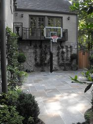 The Multitasking Patio:The children wanted a basketball court, Mom wanted an outdoor yoga studio and Dad envisioned catered events in a distinctive garden. Everyone got what they wanted.