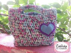 Crochet handbag, made by t-shirt yarn, with simple  flannel brooch
