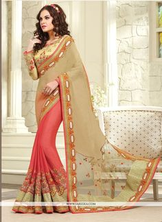 Sensible colors and excellent designs and romantic moods are reflected with an alluring style. Add richer looks to your persona in this majestic beige pure crepe and net designer saree. Look ravishing...