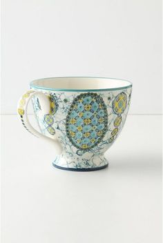 Kebaya Mug.  #073191  $12.00 Turquoise. http://www.anthropologie.com/anthro/catalog/productdetail.jsp?id=073191&catId=HOME-TABLETOP-DINNERWARE&navCount=66&navAction=top&isProduct=true&pushId=HOME-TABLETOP-DINNERWARE&popId=HOME-TABLETOP-DINNERWARE&fromCategoryPage=true&color=046&subCategoryId=HOME-KITCHEN-MUGS
