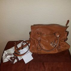 Michael Kors brown handbag Brown MK handbag with gold hardware. Dust bag and strap included. Worn a couple times, great condition. Some pin marks inside. Michael Kors Bags