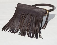 Pair this with your favorite jeans. So soft! Genuine leather. I love this purse! Chocolate fringe cross body bag. Handmade by VickiDesignsCA