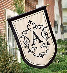 Monogram Estate Flag by Problem Solvers. $39.95. Monogram Estate Flag. Set your home apart with our hand-crafted, estate-size Monogram Flag. It's the elegant way to greet guests, make an impression and add flair to your home's exterior. Your family initial features a subtle flourish and is framed beautifully by graceful scroll work. Black detailing and border create an elegant contrast against the neutral off-white background. It's a beautiful accent for your famil...
