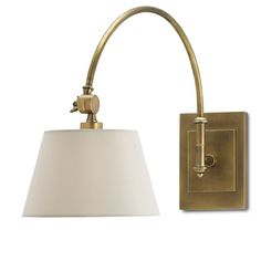 This gorgeous brushed brass bent arm wall sconce is perfect for any room in your house.This substantial sconce is perfect to go over a bedside table or would l