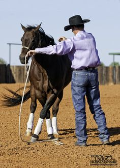 Groundwork Exercise Changing Sides Goal: Without having to move your feet, you should be able to get the horse to change sides, crossing over with his outside front foot, off the lightest amount of steady pressure possible. More about the exercise: ht Horse Training Tips, Horse Tips, My Horse, Horse Love, Horse Riding, Horses And Dogs, Show Horses, Horse Behavior, Horse Exercises