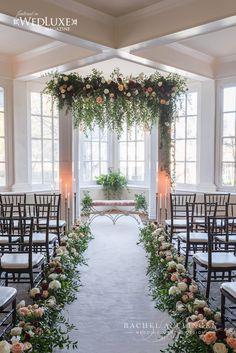 Langdon Hall Weddings Rachel A. Clingen Wedding chuppah canopy with hanging floral treatment.