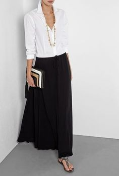 Relaxed white shirt, black maxi and sandals.... easy style ck...good for a hot day, you can spritz with water to keep skirt cool and white top looks great