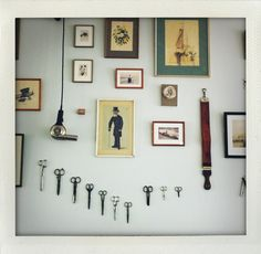 i am drawn to the scissors on the wall. neat idea instead of the common key idea.