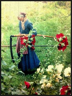 Tasha Tudor & Hollyhocks. I have some of the seeds from her garden. Her father worked on some projects with Buckminster Fuller.