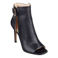 """A sophisticated peep toe bootie takes a sassy turn with a side slit opening while a metal buckle finishes the look. Back zip for easy on/off. Padded footbed for all-day comfort. Leather upper. Man-made lining and sole. Imported. 3 3/4"""" high heels."""