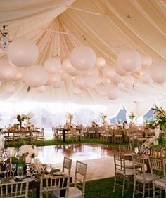 this is what i want for a reception. Beautiful White tents with big lights and a dance floor!!!