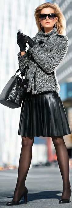 Leather black skirt and gray jacket.
