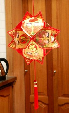 """Happy Chinese New Year! Every year, we celebrate by making these simple decorative lanterns. They're made with """"ang pow"""" wrappers - small red packets that are traditionally filled with money and p. Chinese New Year Party, Chinese Theme, Chinese New Year Decorations, New Years Decorations, Happy Chinese New Year, Chinese Holidays, Chinese Art, New Year's Crafts, Paper Crafts"""