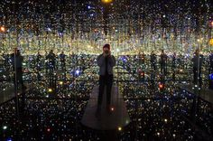 """Eccentric Japanese artist Yayoi Kusama's intriguing art installation at the David Zwirner gallery in New York. The installation's mirror room, """"Souls of Millions of Light Years Away,"""" is brilliantly simple – it's a room in which the walls, the floor and the ceiling are mirrors. This seemingly infinite space is populated by hanging, blinking LEDs, which make the space seem like a galaxy or a nebula."""