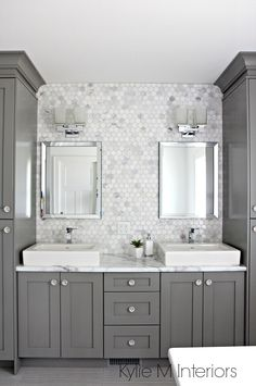 Double vanity in bathroom painted Benjamin Moore Chelsea Gray, hexagon mosaic tile backsplash, Calacatta Marble countertop by Formica. Design by Kylie M Interiors