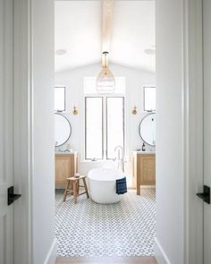 bright bathroom with patterned floor tile