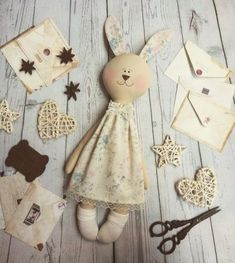 Fleece toy for children Easter Bunny with embroidery flowers Rabbit Crafts, Sock Dolls, Diy Ostern, Fabric Animals, How To Make Toys, Easter Bunny Decorations, Fabric Toys, Bunny Toys, Sewing Dolls