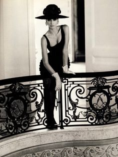 Stunning woman on balcony, lafemmina, femme fatale, black dress, hat, gloves, high class, classy, black and white
