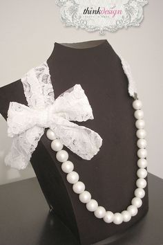 Long pearl necklace with lace ribbon.  Interested in buying?  Please contact @ my_thequill@yahoo.gr