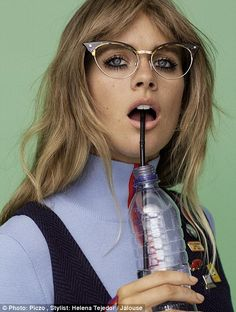 Très chic: In one shot she dons cat-eye spectacles as she sips on a bottle of water through a straw in a shoot styled by Helena Tejedor