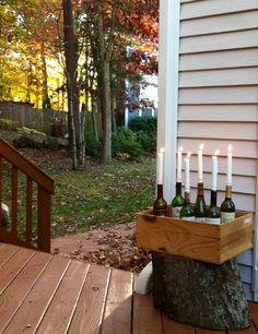 Combine empty wine bottles and taper candles for a cute displays; Janina a la Maison: Outdoor Lighting Informations About Combine empty wine bottles and taper candles for a cute displays; Janina a la Wine Bottle Wall, Empty Wine Bottles, Lighted Wine Bottles, Bottle Art, Solar Light Crafts, Solar Lights, Outdoor Fun, Outdoor Lighting, Outdoor Decor