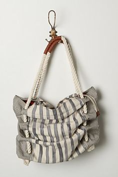 I might just have to have this one as well. Great summer bag!   ***I just got this, and I don't think it is as cute in person, boo!