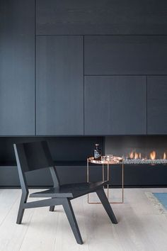 Minimalist side table for a contemporary living room design living room design, furniture ideas, furniture world. See more inspirations at Modern Fireplace, Fireplace Design, Tv Fireplace, Bioethanol Fireplace, Black Fireplace, Interior Design Photos, Interior Design Inspiration, Design Ideas, Daily Inspiration