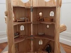 Image result for carved tree trunk fairy house