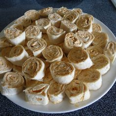 Mexican Roll Ups  Ingredients 1	pkg. Soft taco shells 1	pkg. Cream cheese ½	pkg. Taco seasoning 1½	c. grated cheese 2	tsp. chopped jalapenos small carton of sour cream garlic salt to taste  Directions                    Mix the above ingredients (except the shells) and spread on each soft taco shell.  Roll, slice, and refrigerate.