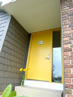 Someday our front door will be a fun color like this one.  Maybe yellow, orange, or lime green.