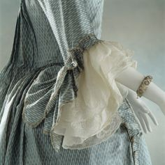 Detail of sleeve, robe à la francaise, 18th century. Pale blue silk trimmed with gold lace. (Killerton Costume Collection, at Killerton, Devon)