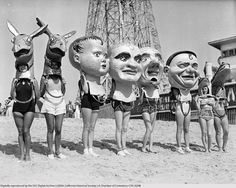 Women wearing oversized masks on the beach in Venice, ca.1930. USC Libraries Special Collections digitallibrary.us...
