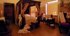 Replica of a Tudor 'birthing room'.  In some instances, midwives and mothers were aided by a birth chair, specifically designed for delivery. The seat of a chair would have a cut out, or key hole section where the midwife would have delivered the newborn.  The chairs also had a straight back that assisted gravity and moved the birth process forward to completion.