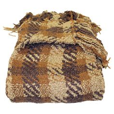 Throw with a hand-knotted fringe trim and plaid design.  Product: ThrowConstruction Material: Acrylic and polyes...