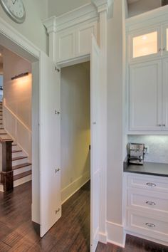 Amazing kitchen with hidden pantry doors disguised as regular cabinets.