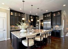 We're celebrating our 10-year anniversary, and while Zillow Digs has only been around since 2013, your favorite home design images are piling up quickly. Here's a selection of the most popular images on Zillow Digs -- a mix of traditional, contemporary and Mediterranean styles that have been saved to thousands of boards -- plus some of your comments on what makes these spaces extraordinary. Cooking with cream This traditional cream kitchen, designed by Custom Kitchens by Martin, features a…