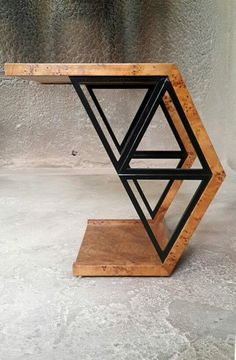 Triangle Coffee Table. Coffee table ideas by looking at these unique and modern coffee table examples. Some are made of wood, some have minimalist designs, etc. #coffe #cupofcoffe #coffetables