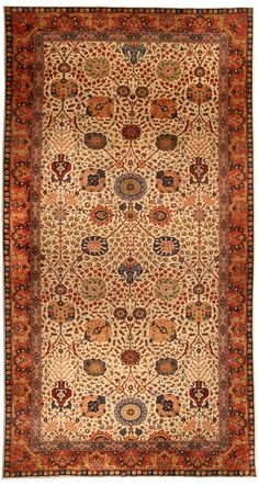 An Indian rug BB4513 - by Doris Leslie Blau.  An early 20th century Indian rug, the ivory field with a restrained trellis of enlarged palmettes and flowerheads ...