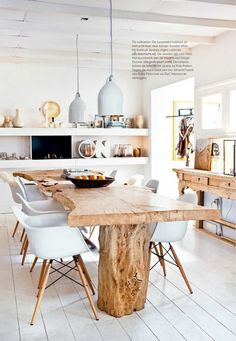 I love a good live edge dinning table. This with the open kitchen and chairs is to die for.