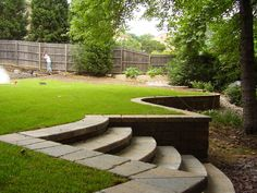 Level a sloped yard with a retaining wall