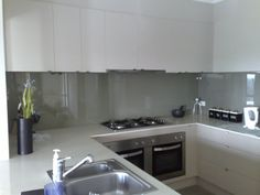 Our Glass Splashback in the kitchen Glass Kitchen, New Kitchen, Kitchen Dining, Kitchen Splashback Tiles, Mirror Splashback, Glass Splashbacks, White Ikea Kitchen, Kitchen Grey, Handleless Kitchen