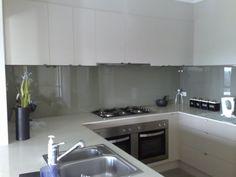 Nice Glass Splashback & cupboards. Compact sink