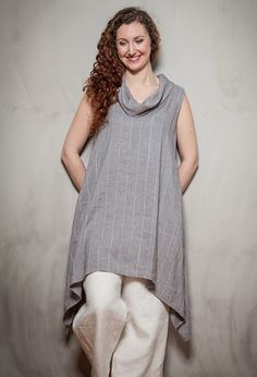 Sleeveless Roll Neck Tunic £245 over Pleated Inset Trousers in white linen £205.