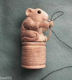 Carved moose antler Mouse on Spool of thread Needle case/saver.  Listed on ebay