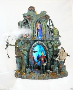 Department 56 Halloween Lit Haunted Scene with Dracula and 2 scary characters inside a run down old house with cobwebs. It lights up in cycles of red and blue colors and comes with cord.