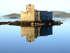 Kisimul Castle is a small medieval castle located in the centre of Castlebay on Barra, an island of the Outer Hebrides, Scotland. It is home to Clan MacNeil.