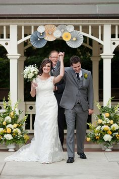 a gray and yellow wedding, a groom in a three piece suit, babys breath bouquets... what is there to not love about this wedding?