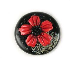 Hey, I found this really awesome Etsy listing at https://www.etsy.com/listing/182630629/black-glass-cabochon-with-red-flower